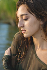summer portrait of a swimming girl, emotional portrait of a girl in the water