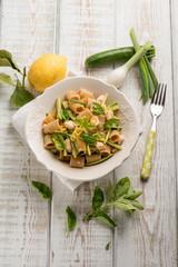 fresh salmon pasta with zucchinis leek and grated lemon peel