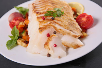 fish fillet cooked with vegetables