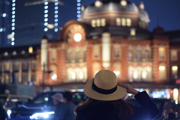 Tourist is looking at Tokyo train station in Tokyo, Japan.