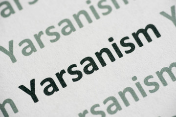word Yarsanism  printed on paper macro