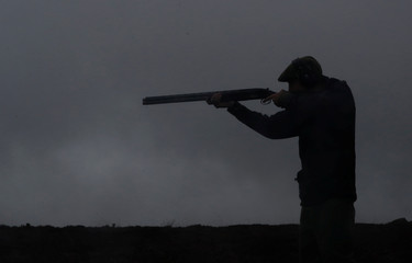 A member of a shooting party takes a shot on Forneth Moor on the opening day of the grouse shooting season, Scotland