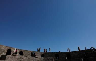 People walk on old city walls in central Ankara
