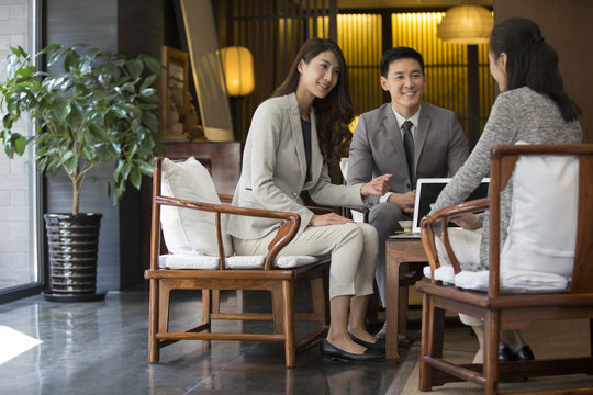 Confident business people talking with a mature woman