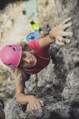 A Woman Climbing a Rock