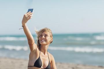 Woman Taking a Selfie on Beach