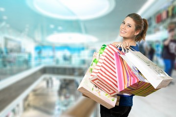 Young woman with bags on shopping