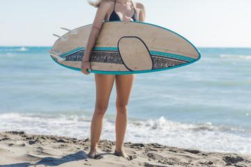 Woman Surfer Walking on Beach