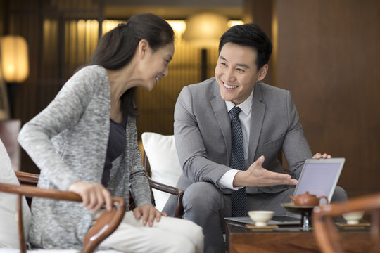 Confident businessman talking with a mature woman