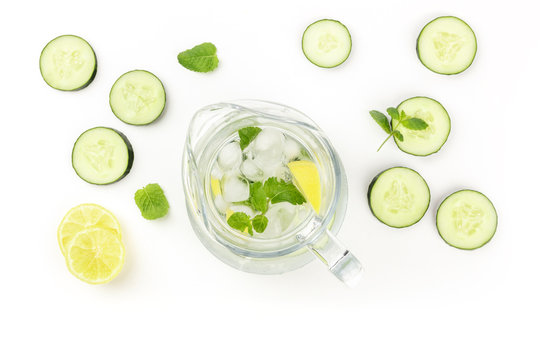 Cucumber, lemon and mint lemonade in a jar on a white background with copyspace