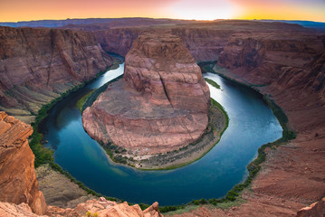 Horseshoe Bend is a beautiful horse-shoe-shaped water meander made by the Colorado River in Arizonian red rock desert landscape, close to Page, Arizona, USA. Scenic view from steep cliffs above