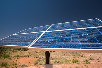 Dark blue solar panels in Arizona desert. Green energy technology, ecology and environmental policy concepts.