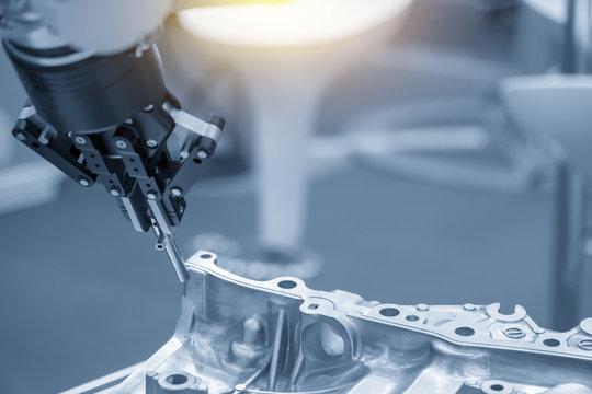 The robot for manufacturing  the aluminum automotive part .The automotive part quality control concept.