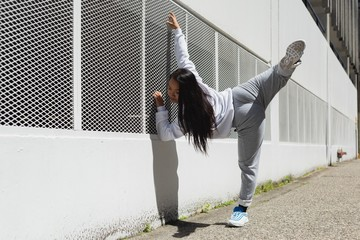Female dancer dancing in the city