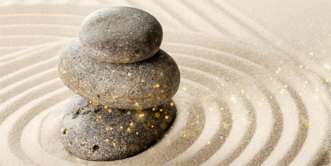 Wall Mural - Zen stone in the sand on Background