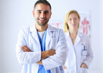 Young and confident doctors portrait standing in medical office