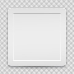 White plastic frame for text, logo or picture is on squared gray background.