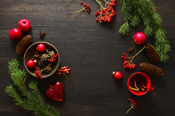 Christmas natural decor stuff on moody rustic table surface