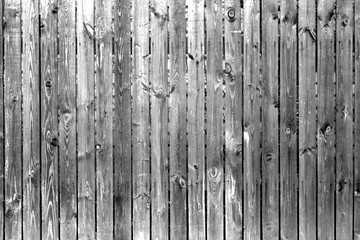 Old wooden fence in black and white.