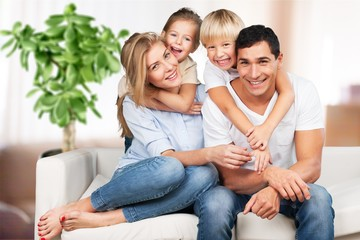 Beautiful smiling family in room