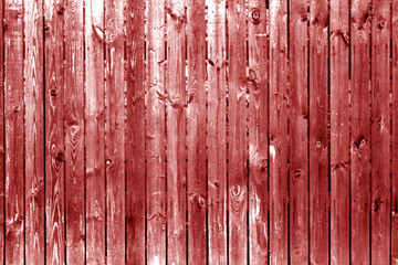 Old wooden fence in red tone.