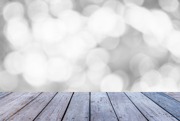 Wood table or wood floor with abstract white bokeh background for product display