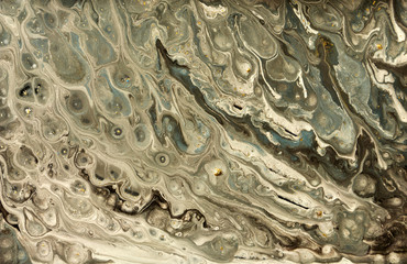 Gold marbling texture design. Beige and golden marble pattern. Fluid art.