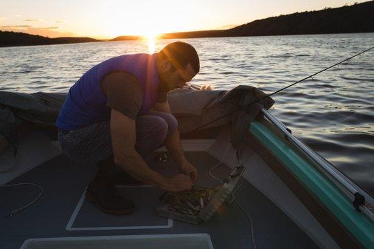 Man preparing bait for fishing