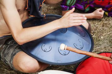 Hang drum player hands in action