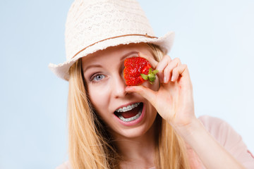 Happy woman holding strawberries
