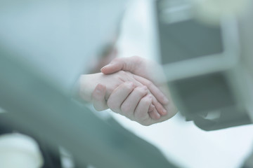 business background.blurred image of business partners shaking hands