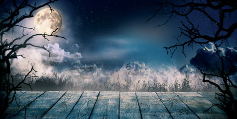 Scary horror background with empty wooden deck