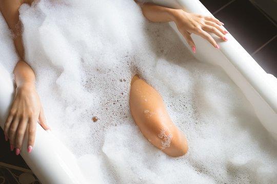 Woman taking a bath in bathtub