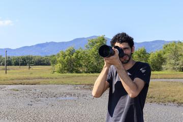 Man photographing nature in dry brazilian mangrove