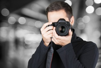 Male Photographer with Camera on background