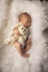 Newborn baby sleeping on baby bed