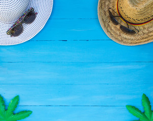 beach accessories on blue wooden board