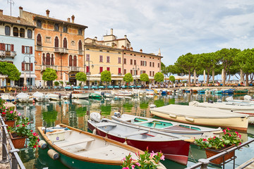 "Harbor with colorful boats in the city of ""Desenzano del Garda"" at Lake Garda in northern Italy"