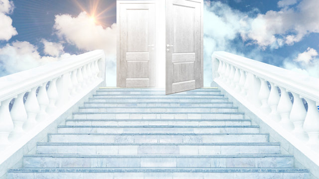 Closed door on the stairs at the top on the clouds, sunlight, magic