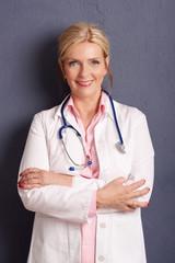 Smiling female doctor portrait. Studio shot