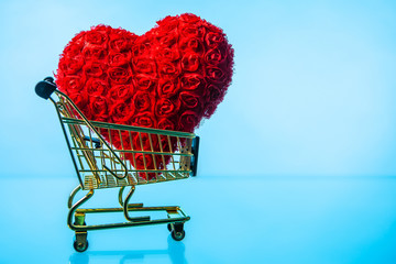 Heart in a shopping trolley. Gold shopping cart. I like shopping. Lovers go shopping. Red heart.
