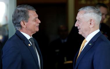 U.S. Secretary of Defence Mattis talks with Brazilian Defense Minister Joaquim Silva e Luna after a meeting in Brasilia