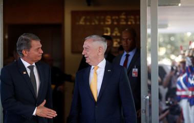 U.S. Secretary of Defence Mattis is greeted by Brazilian Defense Minister Joaquim Silva e Luna after a meeting in Brasilia