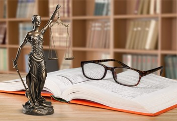 Close-up Black reading glasses and book on