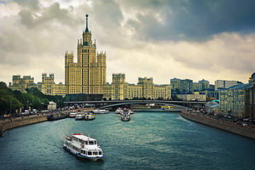 Cityscape view of Moscow river with bridge and ship