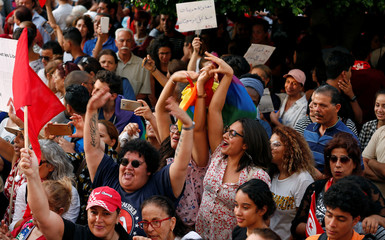 Protesters shout slogans during a rally, demanding equal inheritance rights for women, in Tunis