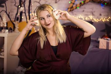 Beautiful girl listening to the music in headphones