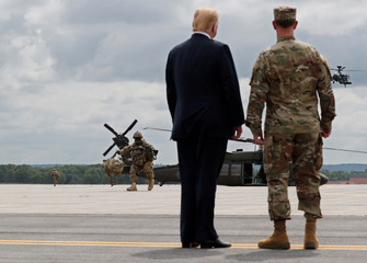 U.S. President Trump observes a demonstration with troops and helicopters as he visits Fort Drum, New York
