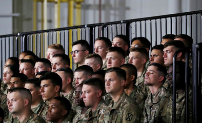 U.S. Army troops listen as President Trump speaks before signing the National Defense Authorization Act at Fort Drum, New York