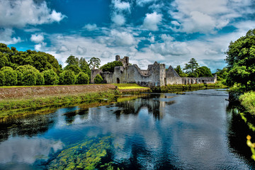 The Desmond Castle in Adare beautifull Village, on the banks of the Maigue River, in Ireland, Co. Limerick. HDR Landscape